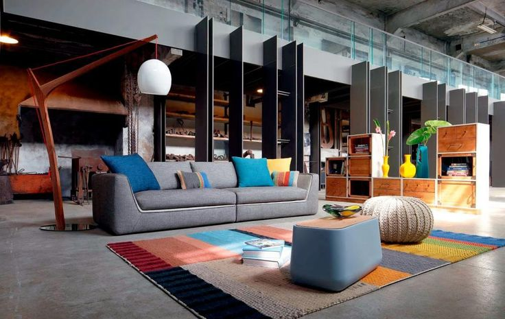 http://www.drissimm.com/wp-content/uploads/2015/02/charming-pillow-design-on-gray-sectional-fabric-sofa-as-well-colorful-rug-under-benches-table-as-well-wooden-cabinet-shelves-in-the-nearby.jpg