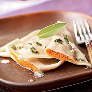 """Pumpkin ravioli with sage brown butter sauce.  I always doctor up this filling with some fresh sage, rosemary, parsley, garlic, ginger, and shallots.  Fantastic.  The wonton wrappers are a little more """"slippery"""" than Italian pasta, but they work well."""