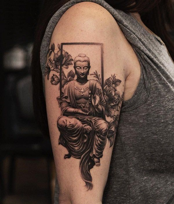 Buddha and flower tattoo
