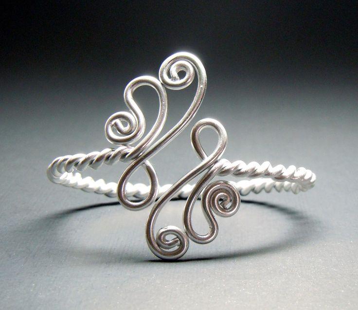 Twisted Paisley Adjustable Bracelet. I am thinking ring.