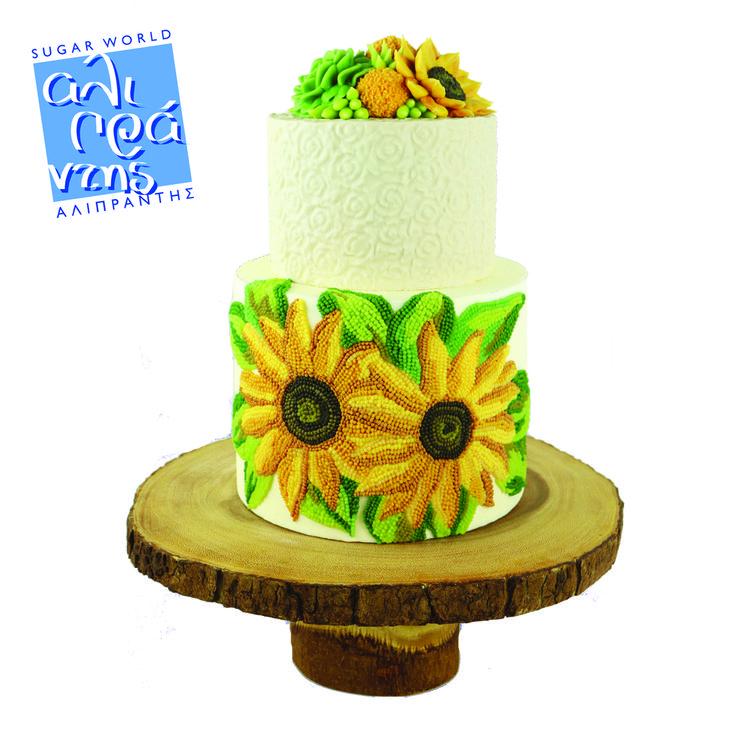 Διακόσμηση τούρτας με ηλιοτρόπια από χάντρες βουτυρόκρεμας  Απολαύστε ένα δυναμικό σεμινάριο με πληθώρα τεχνικών για εντυπωσιακές τούρτες με σχέδια από βουτυρόκρεμα!