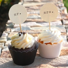 Wedding Cupcake Toppers /// Actually an awesome idea. Not only are cupcakes cheaper, but my future husband and I have COMPLETELY different opinions on foods, so having 50 in his favorite flavor and 50 in mine is AWESOME. :)