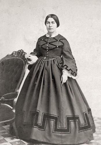 Bodice trimmed different than skirt but sleeves do match skirt. Interesting