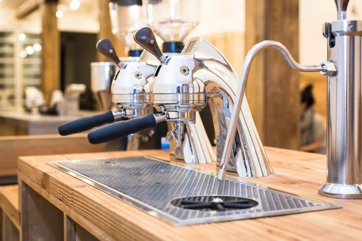Not gonna happen, but I want it.   Another view of the Modbar espresso machines. Note the drains built directly into the counters. Gorgeous.