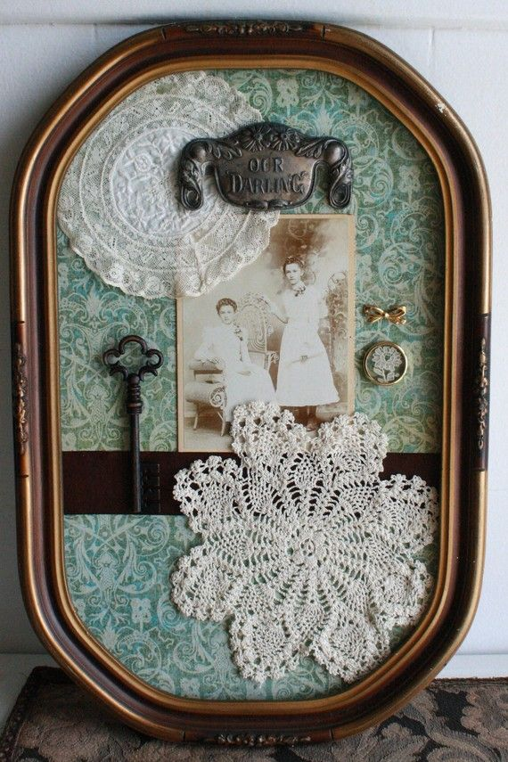Lovely framed display of heritage photos, starched doilies, heirloom jewelry and vintage memorabilia. A nice way to display small things that we might have from our ancestors.