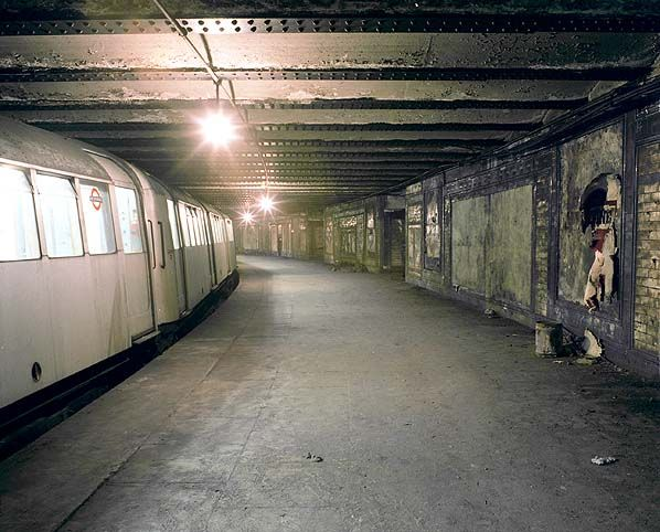 """""""A empty Central Line train passes through the abandoned  Platform 4 in Match 1980 bound for the depot.  Photo by Nick Catford""""    ~ See the Subterranea Britannica site (http://www.subbrit.org.uk/) for more info. on the Wood Lane underground station and other abandoned underground locations across the UK"""