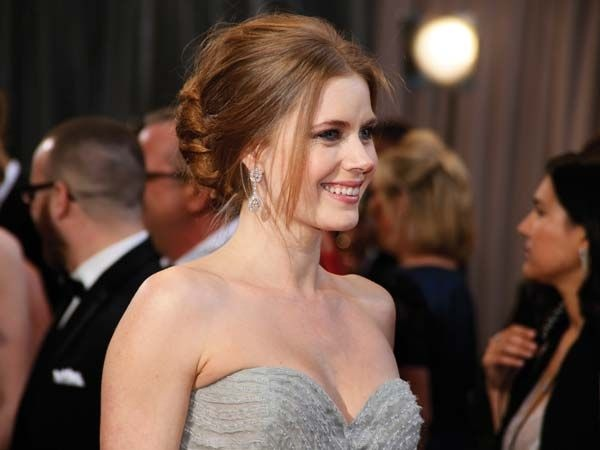 Amy AdamsWhile Amy's ruffled gown was the talk of the town, her simplistic Mouawad earrings formed the perfect companions.