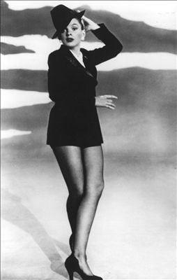 """Judy Garland: Singer/actress Judy Garland had a varied career that began in vaudeville and extended into movies, records, radio, television, and personal appearances. She is best remembered as the big-voiced star of a series of movie musicals, particularly The Wizard of Oz, in which she sang her signature song, """"Over the Rainbow."""""""