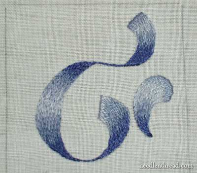 The fifth long and short stitch lesson focuses on stitching around a curve, in order to shade design elements such as ribbon or flowing text.  For basic technique in long and short stitch, feel free to visit Lesson Two, where you will find three videos demonstrating basic long and short stitch. Reading and working through the previous lessons up to this point will help you as well.