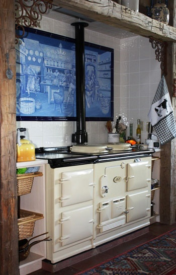 My favorite, rustic, Aga nook with a rough timber overhead