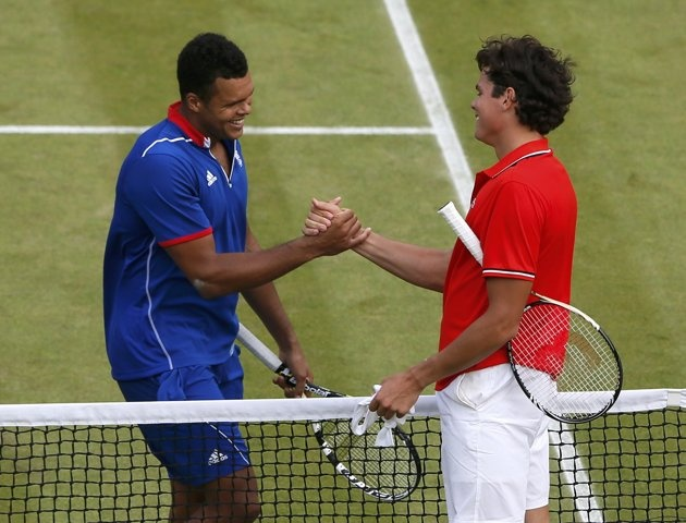 France's Jo-Wilfried Tsonga (L) and Canada's Milos Raonic congratulate each other after their men's singles tennis match at the All England Lawn Tennis Club during the London 2012 Olympic Games July 31, 2012. Tsonga prevailed after winning the third set 25-23. REUTERS/Stefan Wermuth (BRITAIN - Tags: OLYMPICS SPORT TENNIS)