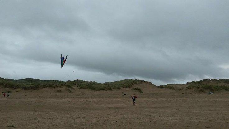 Flying a kite on Saunton Sands beach in August