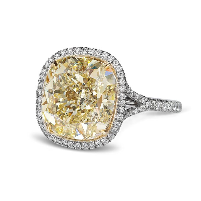Brides.com: 71 Engagement Rings with Colorful Stones. Fancy yellow cushion cut diamond ring with micropavé halo 5.36 CTW, $88,400, Ritani  See more Ritani engagement rings.