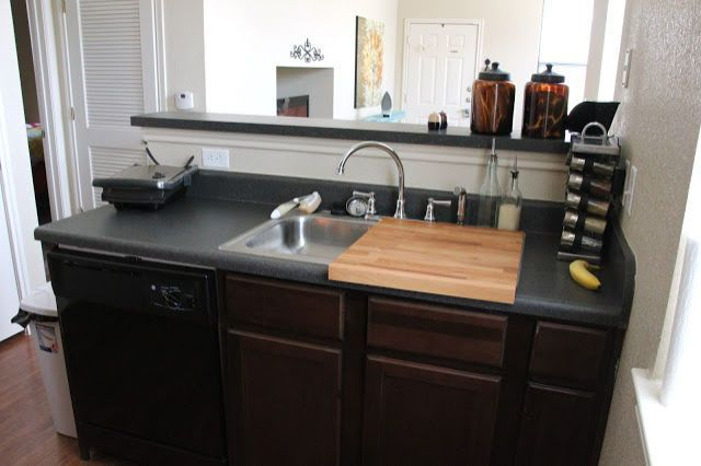 This wooden cutting board fits snugly on top of one side of your sink (while the other half remains open in case someone needs some H2O) and is especially handy if you have a wide sink that takes up more than half of the counter area (like this one!). See more at Sweet Verbena » - GoodHousekeeping.com