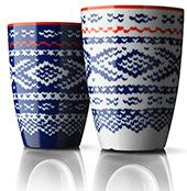 Mugs with the traditional Norwegian knitting pattern Marius in sets of two, black/red or blue/white main colour.