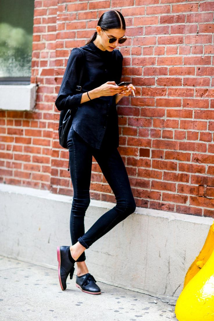 How to get the Model-Off-Duty Look - Try a center part with a slicked-back ponytail + and outfit with an with an all-black color scheme—always 100% flattering for any body type.