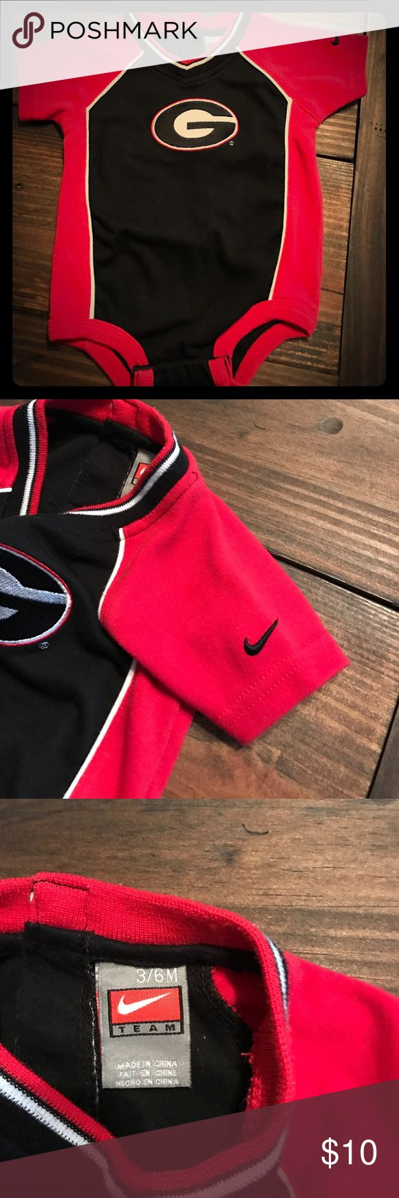 UGA Nike Onesie Georgia Bulldogs UGA Nike baby Onesie 3/6m wore few times. I excellent condition Nike One Pieces Bodysuits