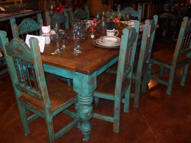 table with turquoise chairs