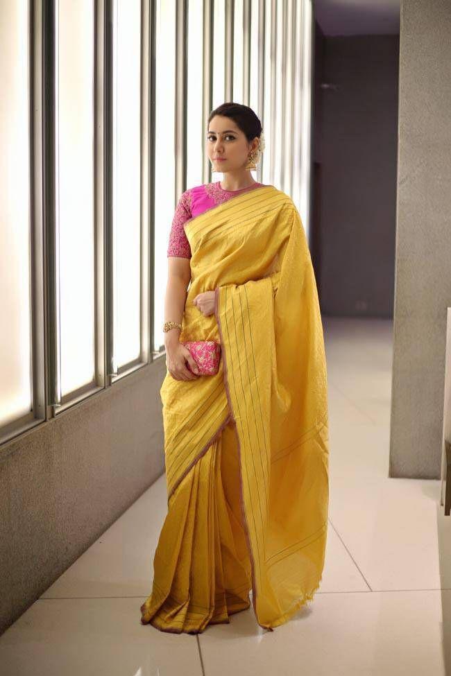 Rashi Khanna Smiling Stills In Yellow Saree At Director Krish Marriage