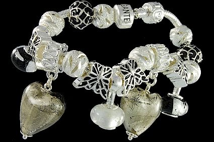 silver plated items: bracelet with snap closure, enamel beads, two glassdangles, balls, lock. Three danglebeads.