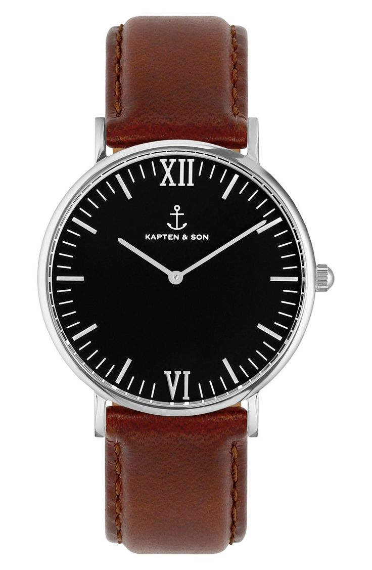 A polished case and glossy leather strap bring classic elegance to a handsome round watch centered with a dark, understated dial.
