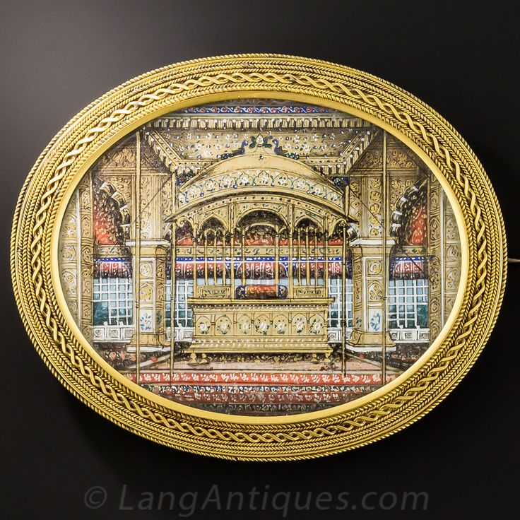 A spectacular treasure (especially if you posses exceptional close-up eyesight!) dating from mid-to-late-nineteenth century Great Britain. The interior of the historic (and long lost) Peacock Throne of The Red Fort in Delhi, India is colorfully and miraculously hand-painted in excruciating detail, and is beautifully and intricately framed in 15ct. yellow gold in this unique, magnificent and collectable brooch measuring an impressive 3 inches by 1 and 1/2 inches. The Red Fort is pictured ...