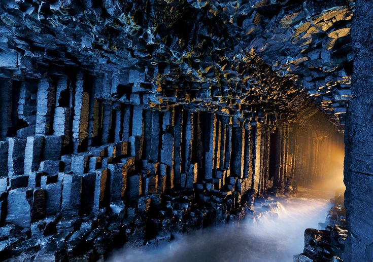 "Fingal's Cave is located on the uninhabited rock island of Staffa, off the West coast of Scotland. This fascinating cave is formed from hexagon shaped basalt columns. The basalt formed into hexagonal columns when a lava flow cooled in the ocean. The lava flow that created Fingal's Cave also created the amazing Giant's Causeway rock formation in Scotland. In Gaelic, Fingal's Cave is known as Uamh-Binn, meaning ""cave of melody"", due to the lovely sounds made by echos of waves crashing inside."