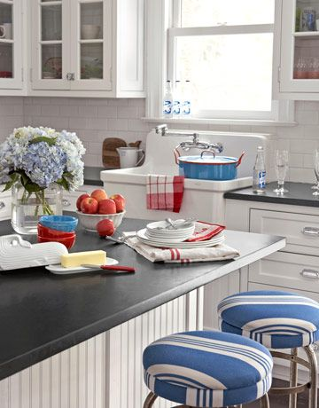 Kitchen Counter  Fresh hydrangeas, tucked into a jar, set the tone for a casual, come-as-you-are kitchen. Striped stools, graphic linens, and a witty whale of a butter dish further the effect. Similar striped fabric on the stools; calicocorners.com. Vintage enamelware stockpot,    Read more: Nautical Home Decor - Seaside Style - Country Living