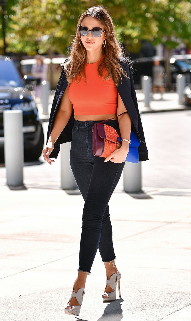 Jessica Alba in an orange crop top, black blazer, high-waisted jeans and gray Nicholas Kirkwood heels - click through for more celebrity outfit ideas!