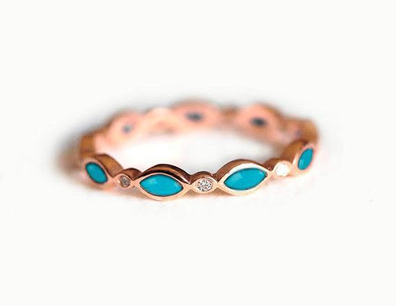 This one-of-a-kind turquoise and diamond band: | 19 Stunning Wedding Bands That'll Outshine Your Engagement Ring