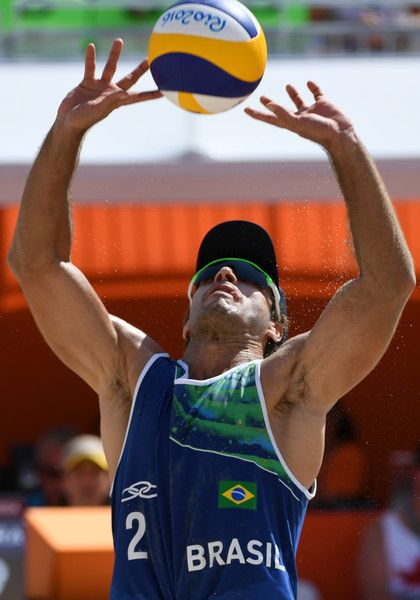 Brazil's Bruno Oscar Schmidt controls the ball during the men's beach volleyball qualifying match between Brazil and Canada at the Beach Volley Arena in Rio de Janeiro on August 6, 2016, for the Rio 2016 Olympic Games. / AFP / Yasuyoshi Chiba
