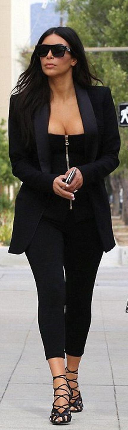 Kim Kardashian: Shirt – Balmain  Sunglasses- Saint Laurent  Shoes – Tom Ford  Jacket – Faith Connexion  Pants – Alaia