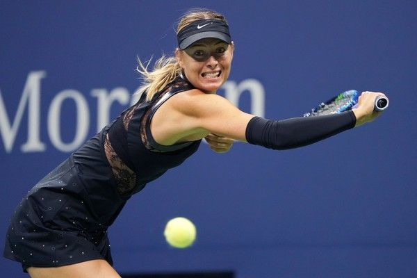 Russia's Maria Sharapova returns the ball against Sofia Kenin of the US during their 2017 US Open Women's Singles match at the USTA Billie Jean King National Tennis Center in New York on September 1, 2017. / AFP PHOTO / Don EMMERT - 864 of 962