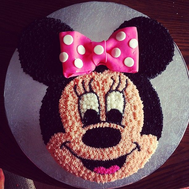 Minnie Mouse Cake! I used 2 round 9 inch cake pans and cut the ears out with a…