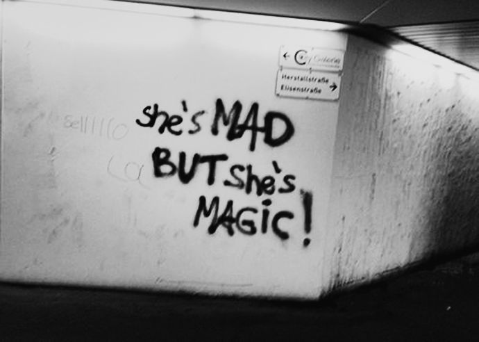 She is mad, but she is magic. There's no lie in her fire - Charles Bukowski - Street art