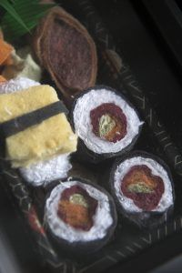 Faux sushi made from lint -- Art created by UC Irvine alumna Slater Barron.   See her story at: https://news.uci.edu/feature/the-first-lady-of-lint/