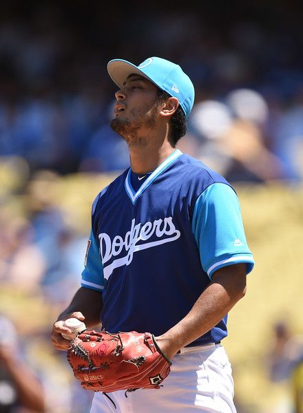 Yu Darvish Photos Photos - Pitcher Yu Darvish #21 of the Los Angeles Dodgers reacts after giving up a run  against the Milwaukee Brewers during the first inning at Dodgers Stadium August 27, 2017, in Los Angeles, California. - Milwaukee Brewers v Los Angeles Dodgers