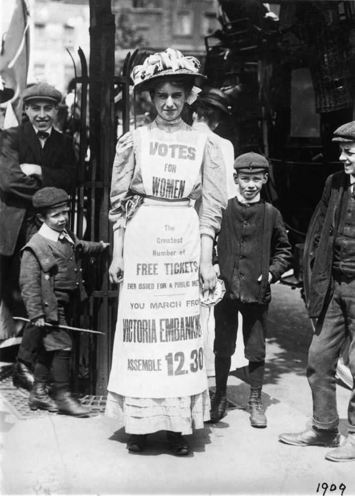 When life hands you stiff, uncomfortable apparel, make a pro-suffrage billboard. Emmeline Pankhurst, among the most famous voices in the English suffrage movement, advertises a march for women's suffrage in 1909.  - 27 Badass Images Of Women Winning And Exercising The Right To Vote