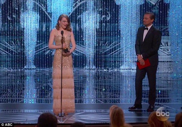 DiCaprio appears to hold on to the envelope after Emma Stone picks up her award and gives her speech, leading one person to believe he left it backstage and Beatty picked it up