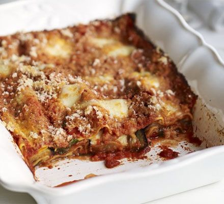 Melanzane lasagne. Aubergines, garlic, passata, dried oregano, sugar, red wine vinegar, fresh basil, parmesan, mozzarella, lasagne sheets, breadcrumbs