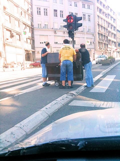 Transporting a piano in Belgrade, Serbia.