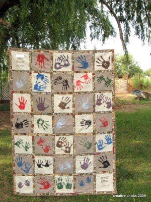 I love this idea! Everyone sign their name and put their hand on a quilt block! This requires a yearly reunion so it can be brought out every year! Just Sayin'!