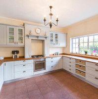 Classic Kitchens. Solid bamboo worktops. Folk stone grey pvc wrap.