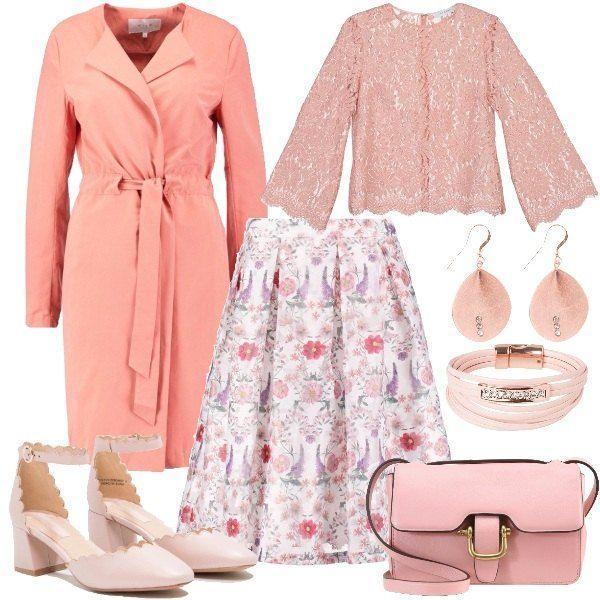 Una gonna romantica a campana con stampa floreale è il pezzo forte di questo outfit. La gonna viene accompagnata da una camicetta in pizzo rosa con maniche a campana e un classico trench con cintura in vita. Le scarpe sono décolleté rosa con cinturino sulla caviglia, mentre la borsa è a tracolla in pelle. Il look si completa con un fantastico set formato da orecchini e braccialetto color oro rosa.