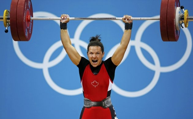 Canada's Christine Girard competes on the women's 63Kg weightlifting competition at the ExCel venue at the London 2012 Olympic Games July 31, 2012. REUTERS/Paul Hanna (BRITAIN - Tags: SPORT OLYMPICS SPORT WEIGHTLIFTING