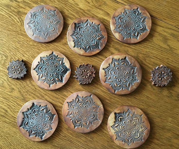 Red iron oxide coasters. Pottery. Mandala design. Tile.