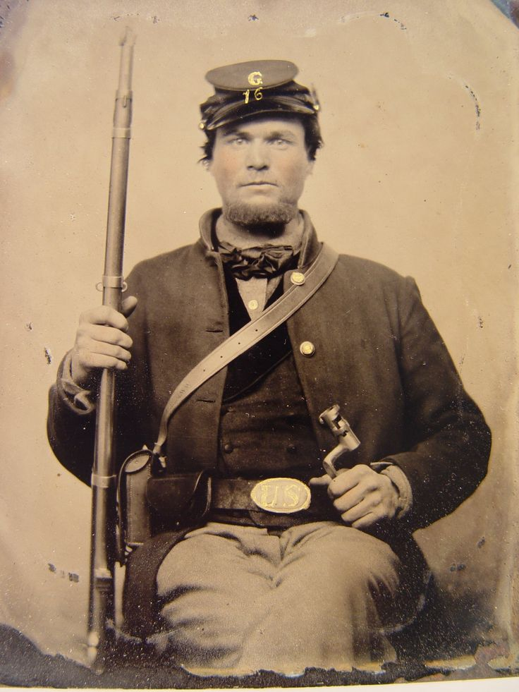Private Horace H. Smith of Company G, 16th Wisconsin Infantry Regiment, in forage cap with bayonet, musket, cartridge box, and musket sling etched H. H. Smith. From: Soldiers of the Civil War.