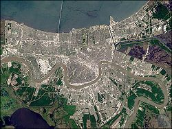 New Orleans - A true-color satellite image of the city showing how it is completely surrounded by water.