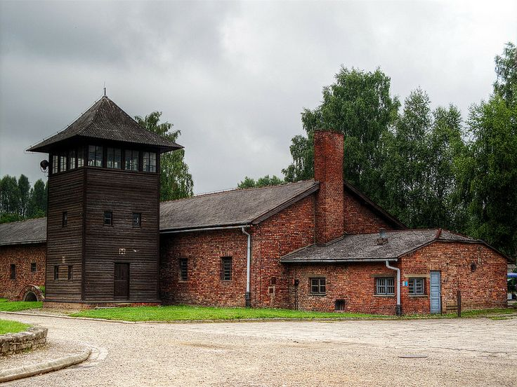 Watch tower 'H' of the Auschwitz I camp. The brick building behind it was camp garages.