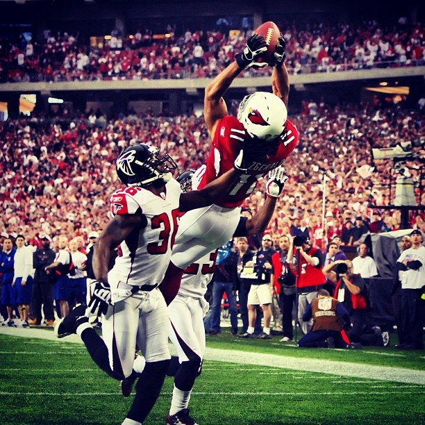 January 3, 2009 - #LarryFitzgerald (@mrfitz11) catches a TD pass against the Falcons during the #NFC #WildCard game.